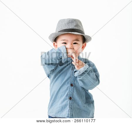 One Year Old Asian Baby Boy In Jeans Shurt Look At Camera  Isolated On White Background Studio Close