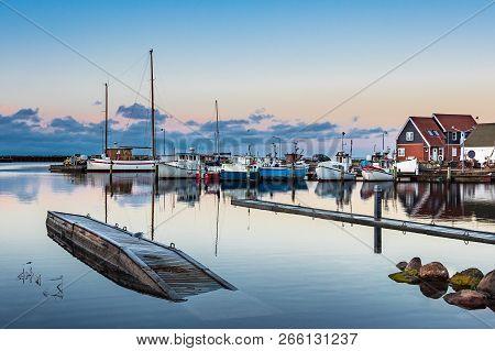 View To The Port Of Klintholm Havn In Denmark.