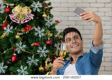 The Caucasian Man With Glass Of Red Wine Is Taking A Selfie With A Gorgeous Smile On His Face In The