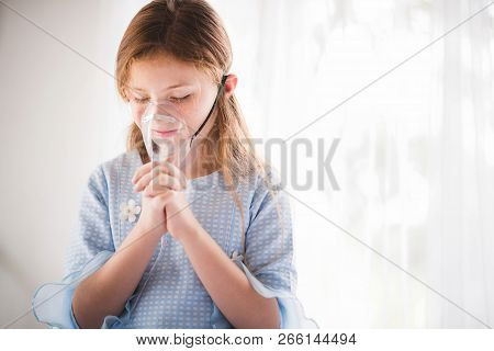 The Little Girl Wearing An Oxygen Mask Was Praying To Be Healed At The Hospital.