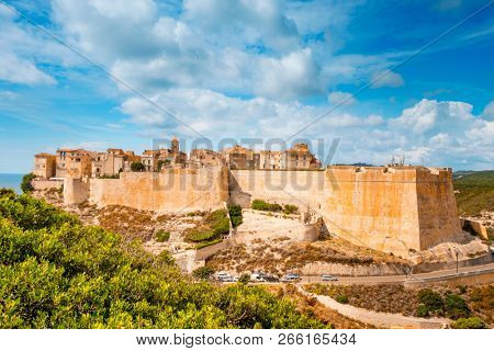 a view of the picturesque citadel of Bonifacio, in Corse, France, on the top of a promontory, with the Mediterranean sea in the background