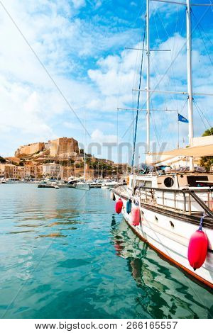 a view over the Mediterranean sea at the port of Bonifacio, in Corse, France, with its famous citadel in the background on the top of a promontory