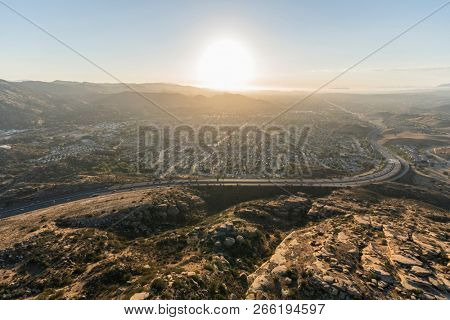 Aerial sunset view of the 118 freeway, Santa Susana Mountains and suburban Simi Valley near Los Angeles, California.