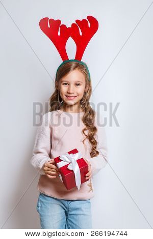 Happy Little Smiling Girl With Christmas Gift Box. Happy Little Smiling Girl With Christmas Gift Box