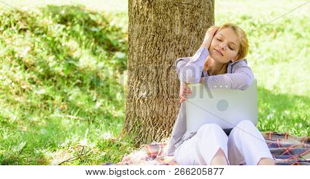 Girl Laptop Dreaming In Park Sit On Grass. Dream About Successful Project. Woman Dreamy With Laptop