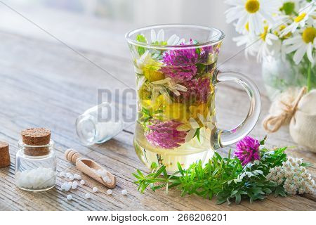 Two Glass Mugs Of Healthy Herbal Tea Or Infusion, Bottles Of Homeopathic Globules And Medicinal Herb