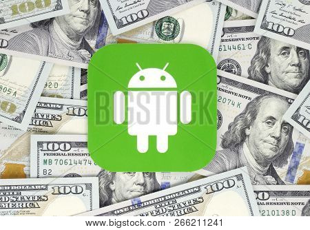 Kiev, Ukraine - September 18, 2018: Android Icon Printed On Paper, Cut And Placed On Money Backgroun