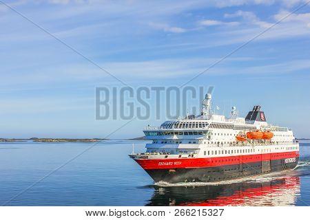 Norway, Europe - May 4, 2011: Two Hurtigruten Sail In Norwegian Waters. Norwegian Postal Boat Crosse