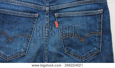 Moscow, Russia - October 29, 2018: Denim Blue Jeans Back Side Pockets With Empty Red Tag, Close Up T