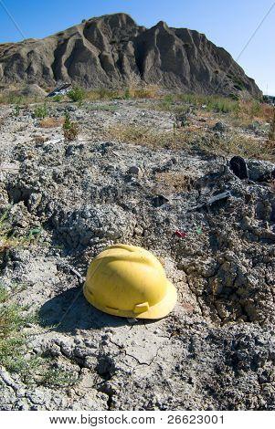 yellow helmet abandoned in desert land