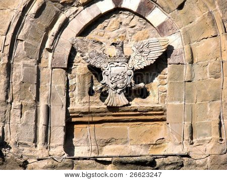 Artistic and old coat of arms of a eagle  of white stone poster