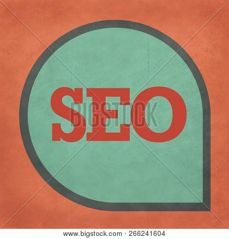 SEO web icon in speech bubble.
