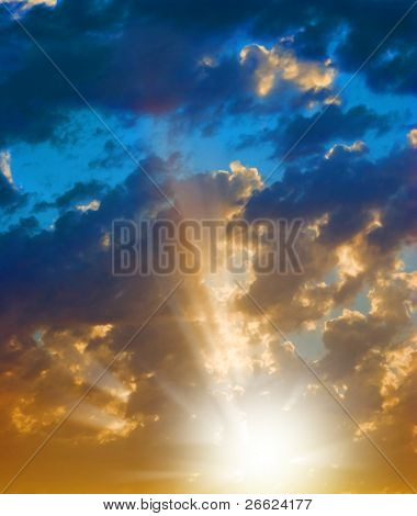 rays of light in the cloudy sky at the sunset