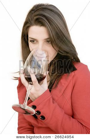 a beautiful woman smell a red glass wine