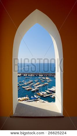 old arched window on harbor of Amalfi