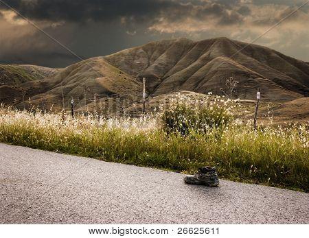 Landscape stormy one shoe worn on road