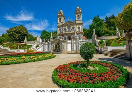 Neoclassical Basilica Of Bom Jesus Do Monte Surrounded By Bloom Gardens In A Sunny Day With Blue Sky