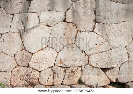 Cyclopean wall of oracle Delphi - Greece - characterized by the use of massive stones of irregular shape and size of passage