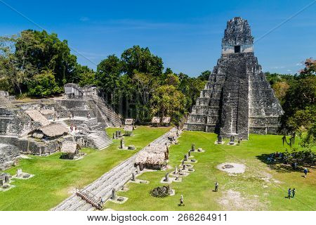 Tikal, Guatemala - March 14, 2016: Tourists At The Gran Plaza At The Archaeological Site Tikal, Guat