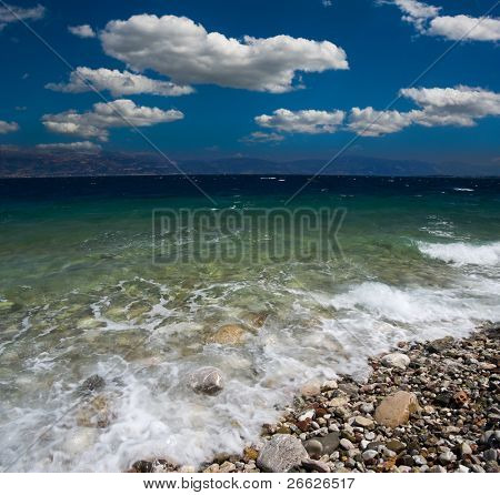 dramatic cloudscape on shore of the greek sea of Corintho strait