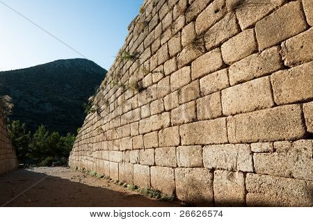Cyclopean wall of The Treasury of Atreus or Tomb of Agamemnon at ancient Mycenae characterized by the use of massive stones of irregular shape and size of passage