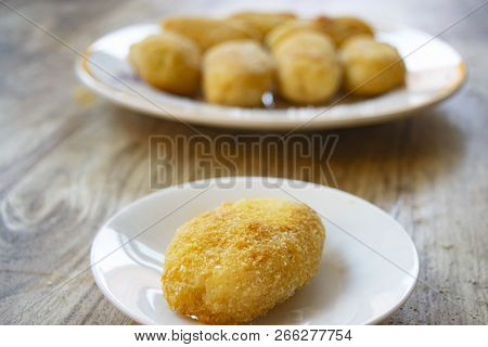 Fried Potato Rissole On A White Dish
