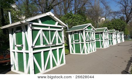 in a row wooden prefabricated building green and white