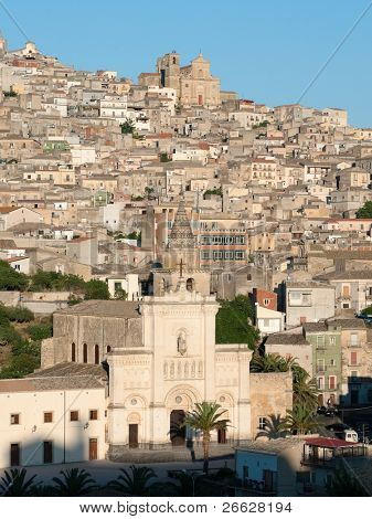 view of the houses and the churches on the hill on which stands the village of Agira in Sicily