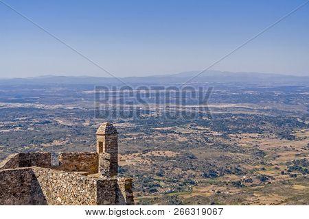 Marvao Castle walls and sentry box with Alentejo landscape. Spain border territory near the horizon. Marvao, Alto Alentejo, Portugal