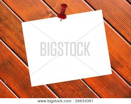 Pined blank paper on wooden planks