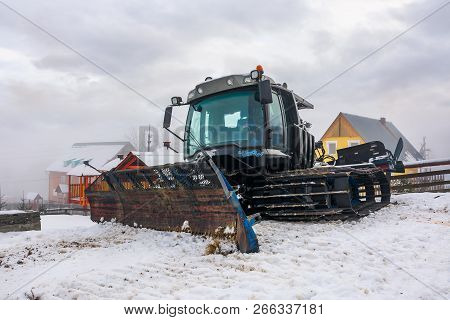 Pylypets, Ukraine - Dec 21, 2016: Snow Groomer Parked In The Resort Village. Huge Machinery Without