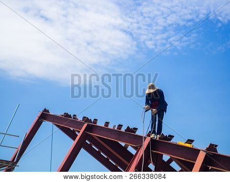 The Welder man a welding the steel roof, worker with unprotected and unsafety, Electric iron oxide. poster