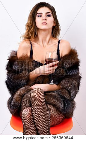 Could Be Yours. Woman Seductive Model Enjoy Wine Wear Luxury Fur And Elite Lingerie. Girl You Dream