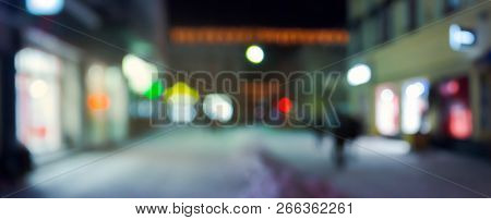 Panorama Of Night Street In Winter. City Light And Glowing Shop Windows. Christmas Sales Concept. Bl