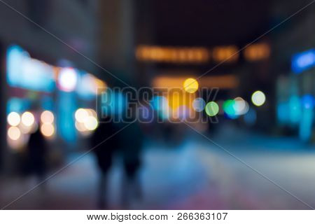 Winter City In Evening. Abstract Blur Background. Christmass Shopping Concept