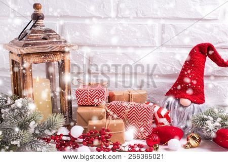 Christmas And New Year Decorations. Elf, Wrapped Christmas Presents, Fur Tree Branches, Balls, Burni