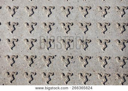 Concrete Pavement With Isle Of Man Emblem. Douglas, Isle Of Man.