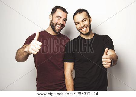 Young Homosexuals Gay Couple Love Each Other On A White Background.