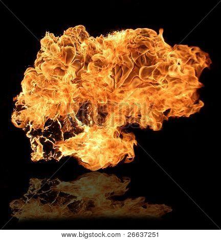 BIg flame on black background reflected on floor