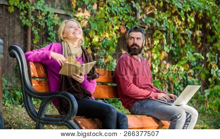 Information Source Concept. Couple Spend Leisure Reading. Couple With Book And Laptop Search Informa