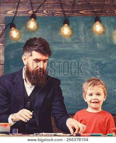 Dad and kid having fun at art class. Daddy and son painting together poster