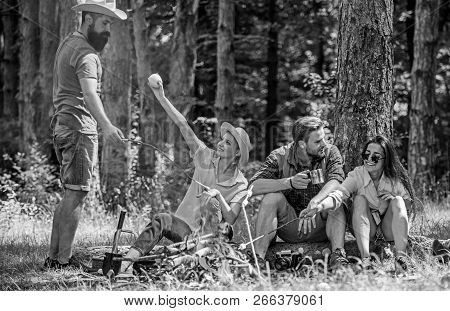 Camping And Hiking. Company Friends Relaxing And Having Snack Picnic Nature Background. Great Weeken