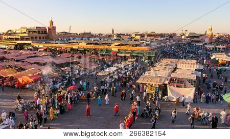Marrakesh, Morocco - Apr 27, 2016: Tourists And Locals On The Djemaa-el-fna Square During Sunset In