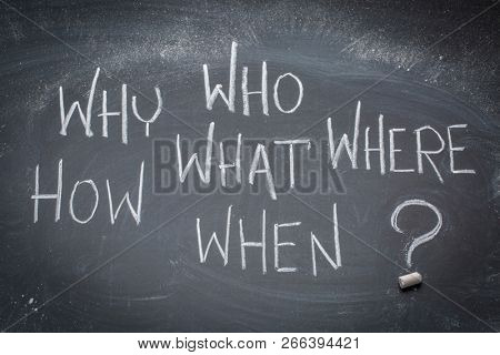 brainstorming questions  (what, when, where, why, how, who) - white chalk handwriting on a blackboard