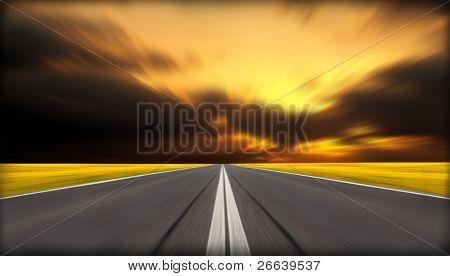 Blurred asphalt road with dark clouds background