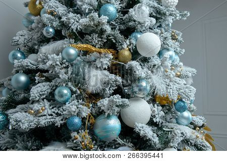 Holiday Decorated Christmas Tree With Toys And Color Balls