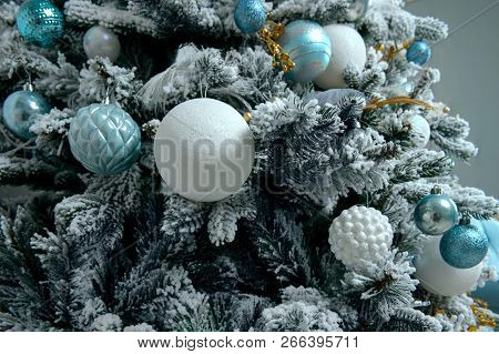 Decorative Christmas Balls On The Christmas Tree On Glitter Background