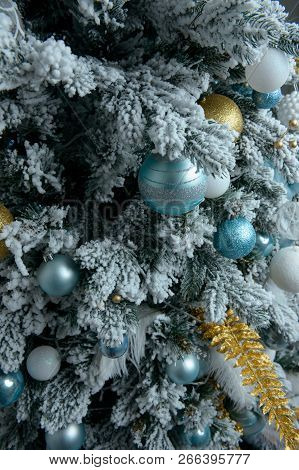 Decorated Christmas Tree With Gifts Close Up On White Background. Christmas Tree Decorated With Yell