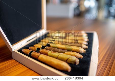 Close-up Of Luxury Cigar Set On The Wooden Table Indoors
