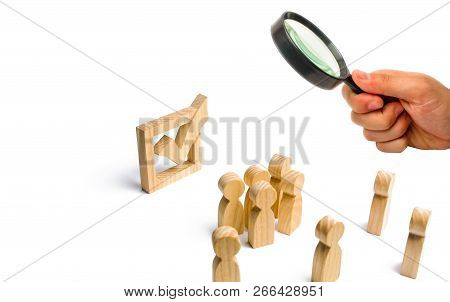 People stand near and look at the check mark in the box. election, poll or referendum. . Voters participate in elections of parliament or president. Decision making, teamwork. Poll Selective focus poster